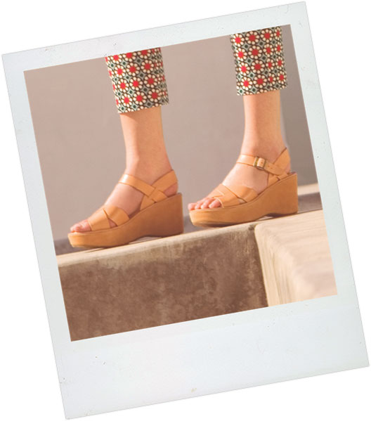 Polaroid of a woman's legs, she is wearing an updated version of the Kork-Ease platform wedge sandal