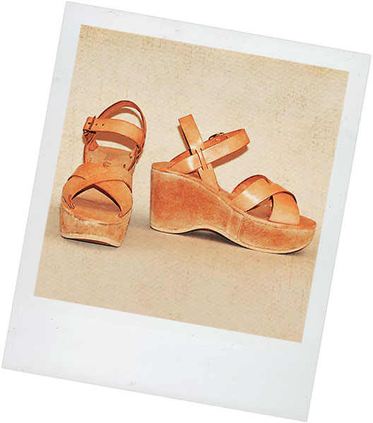 Polaroid of well-worn pair of leather Kork-Ease platform sandals.