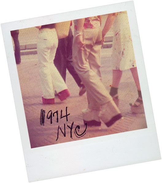 Polaroid of people walking in New York City circa 1974 wearing platform heels.