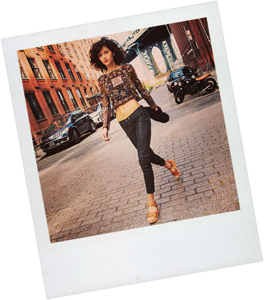 Polaroid of a woman walking on a cobblestone street in Brooklyn, New York, wearing Kork-Ease platform sandals.